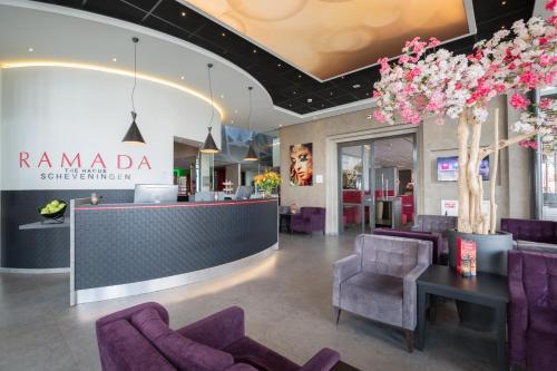 The lobby or reception area at Ramada The Hague Scheveningen