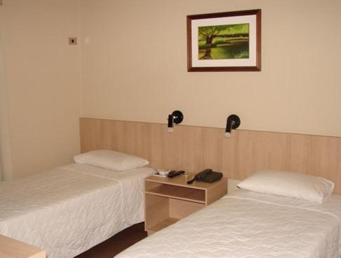 A bed or beds in a room at Muchiutt Park Hotel