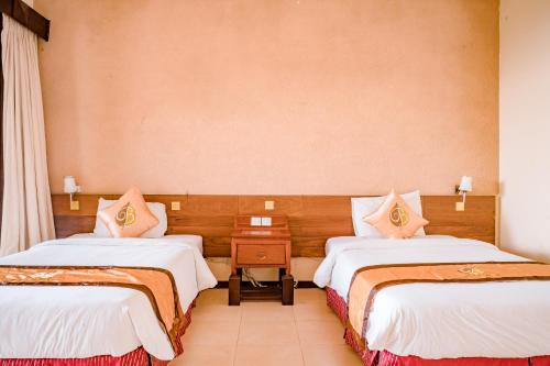 A bed or beds in a room at Belvedere Tam Dao Resort