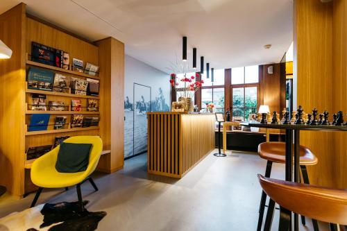 De lounge of bar bij Boutique Hotel 'Hof ter Duinen'