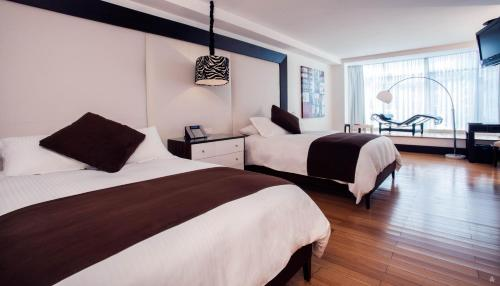 A bed or beds in a room at Le Parc Hotel, Beyond Stars