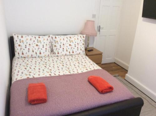 A bed or beds in a room at 96 Rochester Street