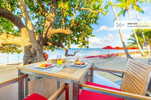 A restaurant or other place to eat at The COAST Adults Only Resort and Spa - Koh Phangan