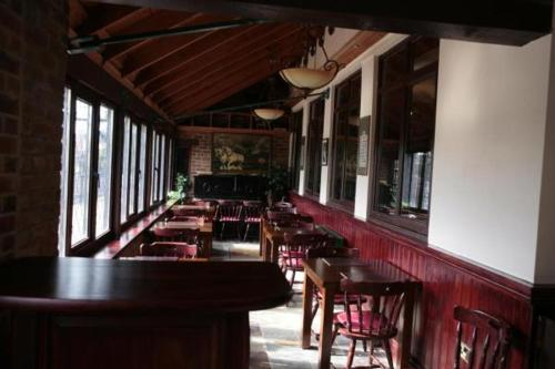 A restaurant or other place to eat at The Plough Inn