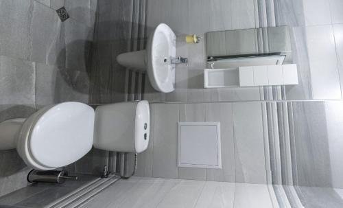 A bathroom at Apartamen Lux