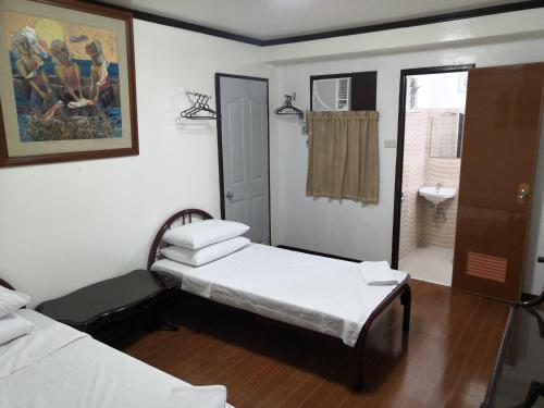Cama o camas de una habitación en Hostel Perla Bohol