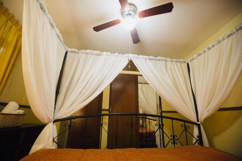 A bed or beds in a room at La Villa Di Ana