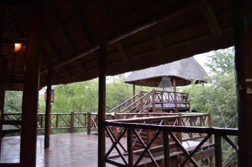 A balcony or terrace at Lion Tree Bush Lodge