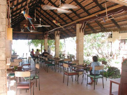 A restaurant or other place to eat at Sea Wind Resort