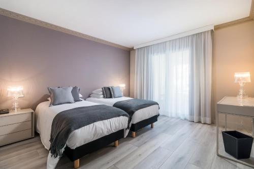 Säng eller sängar i ett rum på Boutique Hotel B51