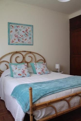A bed or beds in a room at Casa dos Corais