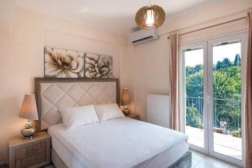 A bed or beds in a room at Corfu City Design Residence