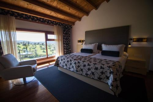 A bed or beds in a room at Hotel Convento San Diego