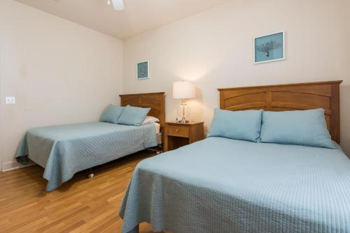 A bed or beds in a room at 3 bedroom villa - accommodate 8 guests