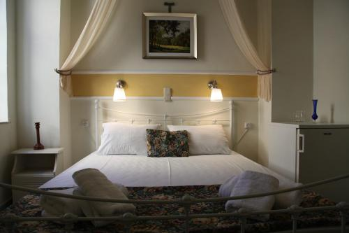 Ένα ή περισσότερα κρεβάτια σε δωμάτιο στο Fiera Guesthouse