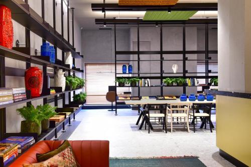 Een restaurant of ander eetgelegenheid bij Porto Palácio Hotel by The Editory