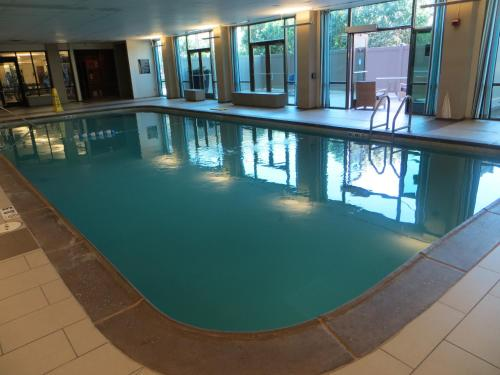 The swimming pool at or near HoteLumiere at The Arch
