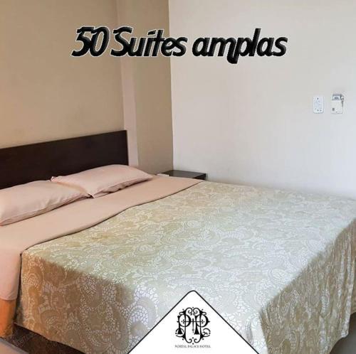 Cama ou camas em um quarto em Portal Palace Hotel