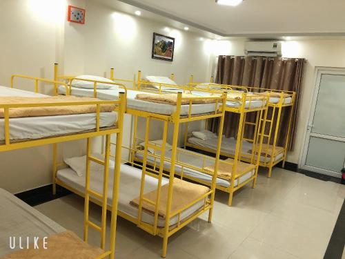 A bunk bed or bunk beds in a room at Anh Anh Guest House