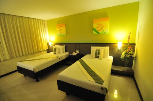 A bed or beds in a room at Navarat Heritage Hotel