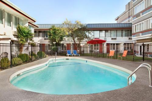 The swimming pool at or near Travelodge by Wyndham Victoria Airport Sidney