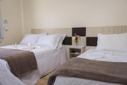 A bed or beds in a room at Hotel Scoz