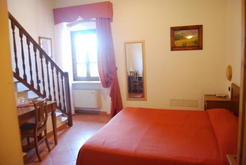 Кровать или кровати в номере Hotel Fattoria Belvedere