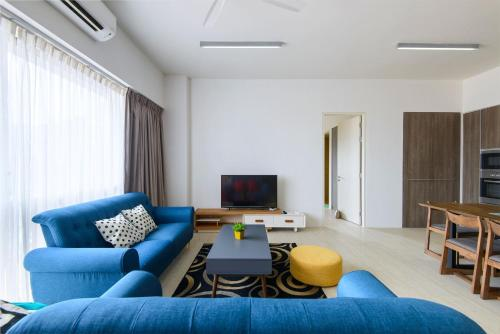 A seating area at By The Sea Beach Front Apartment