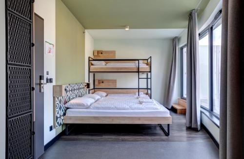 A bunk bed or bunk beds in a room at MEININGER Budapest Great Market Hall