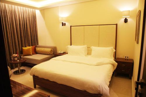 A bed or beds in a room at Grand Concerto Hotel