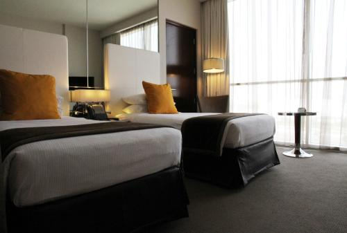 A bed or beds in a room at Centro Yas Island-by Rotana