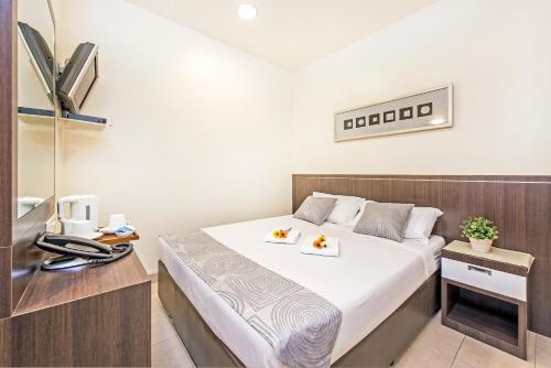 A bed or beds in a room at Hotel 81 Balestier (SG Clean)
