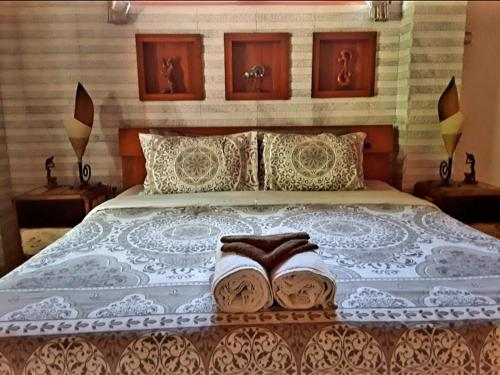 A bed or beds in a room at Gili T Sugar Shack