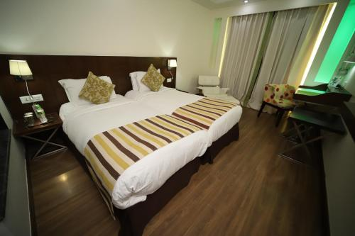 A bed or beds in a room at souvenir peppermint hotel