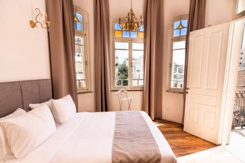 Un ou plusieurs lits dans un hébergement de l'établissement House of Palm - One of a Kind