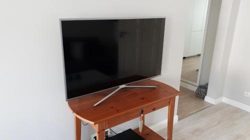 Telewizja i/lub zestaw kina domowego w obiekcie Apartament Paderewskiego 11