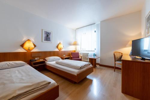 Кровать или кровати в номере Trip Inn Hotel Frankfurt Airport Rüsselsheim