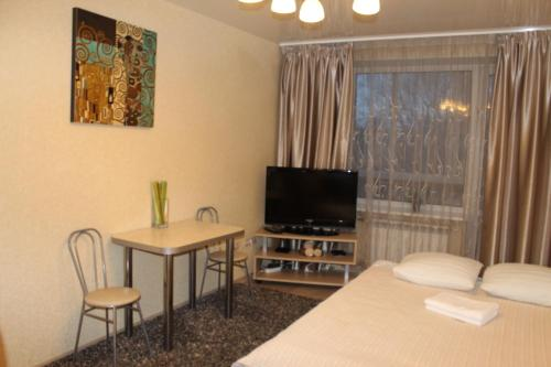 A television and/or entertainment center at Ekaterina Apartments