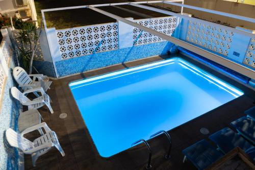 The swimming pool at or near Ity House