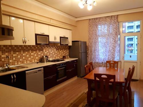A cozinha ou cozinha compacta de SEASIDE BOULEVARD 2 Bedrooms