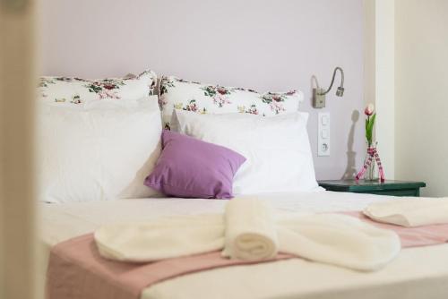 Säng eller sängar i ett rum på Villa Albanis