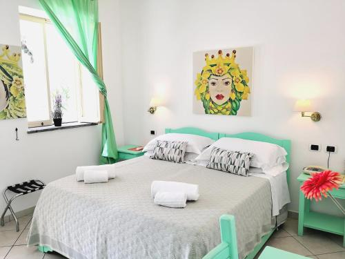 A bed or beds in a room at Hotel Ossidiana Stromboli