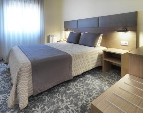 Un ou plusieurs lits dans un hébergement de l'établissement Hotel Santa Maria