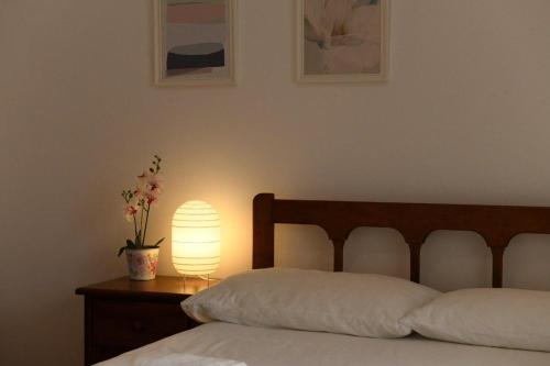A bed or beds in a room at Ericeira Holidays