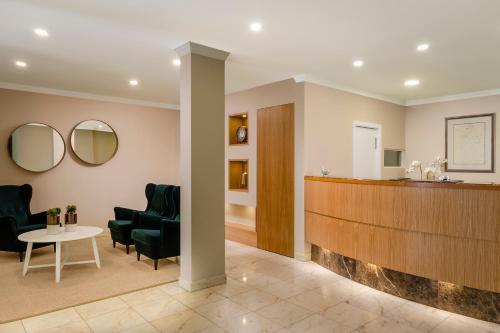 El vestíbulo o zona de recepción de EXE Wellington