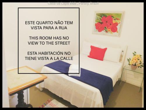Cama ou camas em um quarto em Casa da Lapa