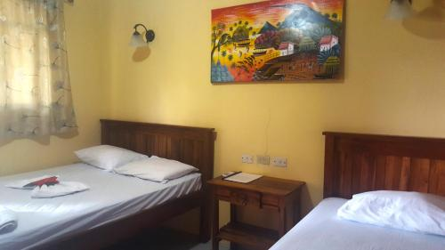 A bed or beds in a room at Hostal Casa Moreno