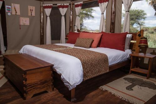 Un ou plusieurs lits dans un hébergement de l'établissement Elephant Bedroom Camp - Samburu