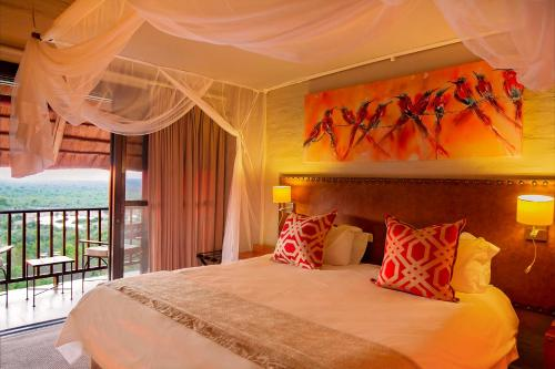 A bed or beds in a room at Victoria Falls Safari Lodge