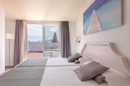 マック プエルト マリーナ ベナルマデナにあるベッド